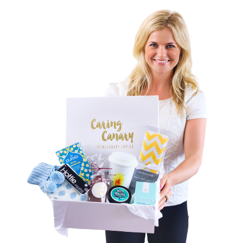 Our Founder Georgia holding a care package