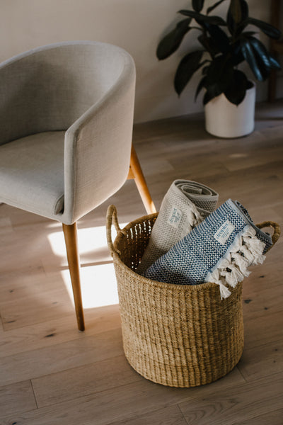 beige and blue blankets rolled in basket