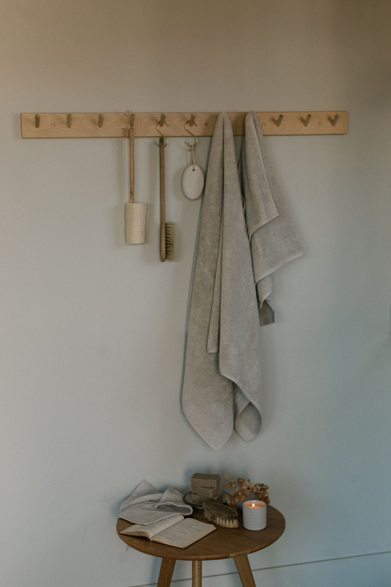 beige organic towel set hanging in pantry