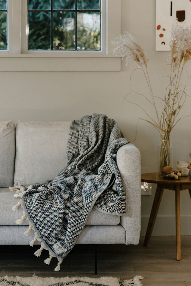 blue organic cotton blanket on sofa