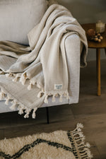 beige organic cotton turkish blanket with tassels