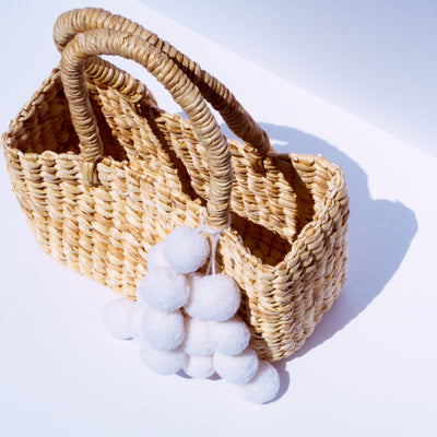 Lovina Water Hyacinth Straw Pom Pom Bag - White