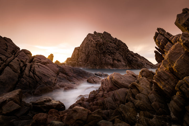 Sunset sky over Sugarloaf Rock at Cape Naturaliste in the South West of Western Australia