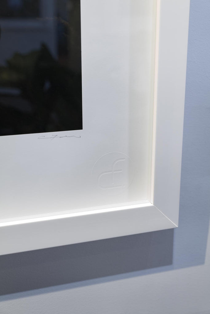 White frame with Christian Fletcher embossed logo photography