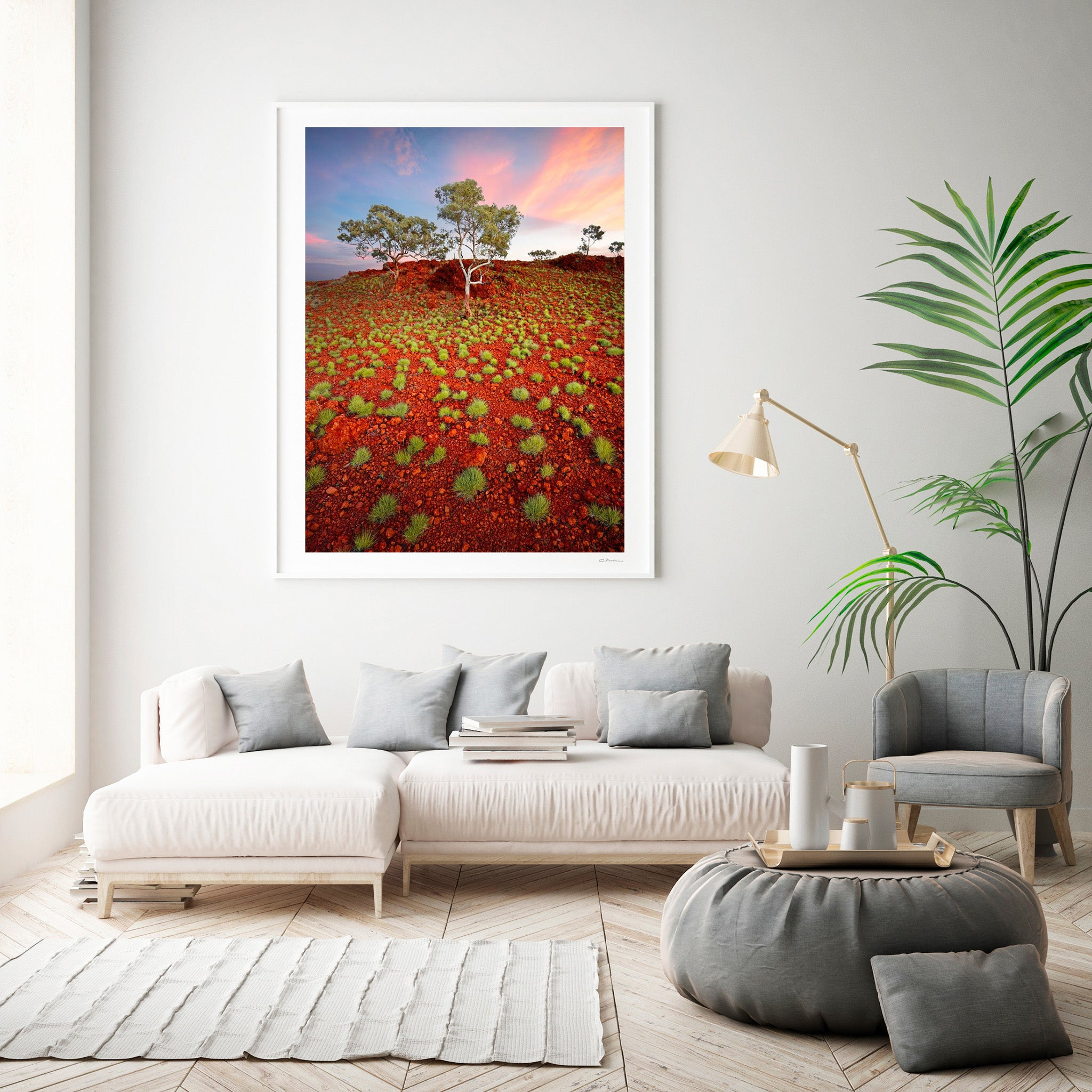 Lounge room with a Christian Fletcher limited edition photograph from Karijini National Park, Pilbara, North Western Australia.  Spinifex, trees at sunset.  Australian orange outback.