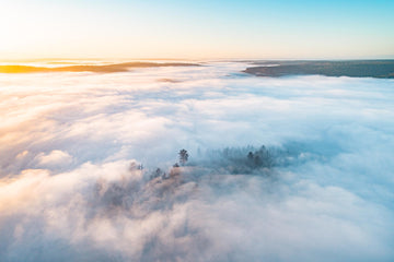 An aerial above a white blanket of cloud cover over the county landscape of Nannup Western Australia