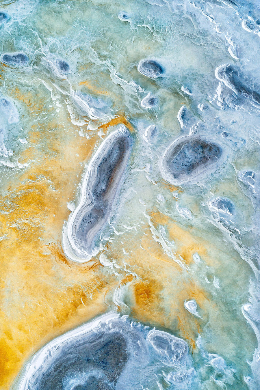 Abstract aerial photograph of a blue and yellow salt lake in the Wheatbelt of Western Australia.  Beautiful soft colours.