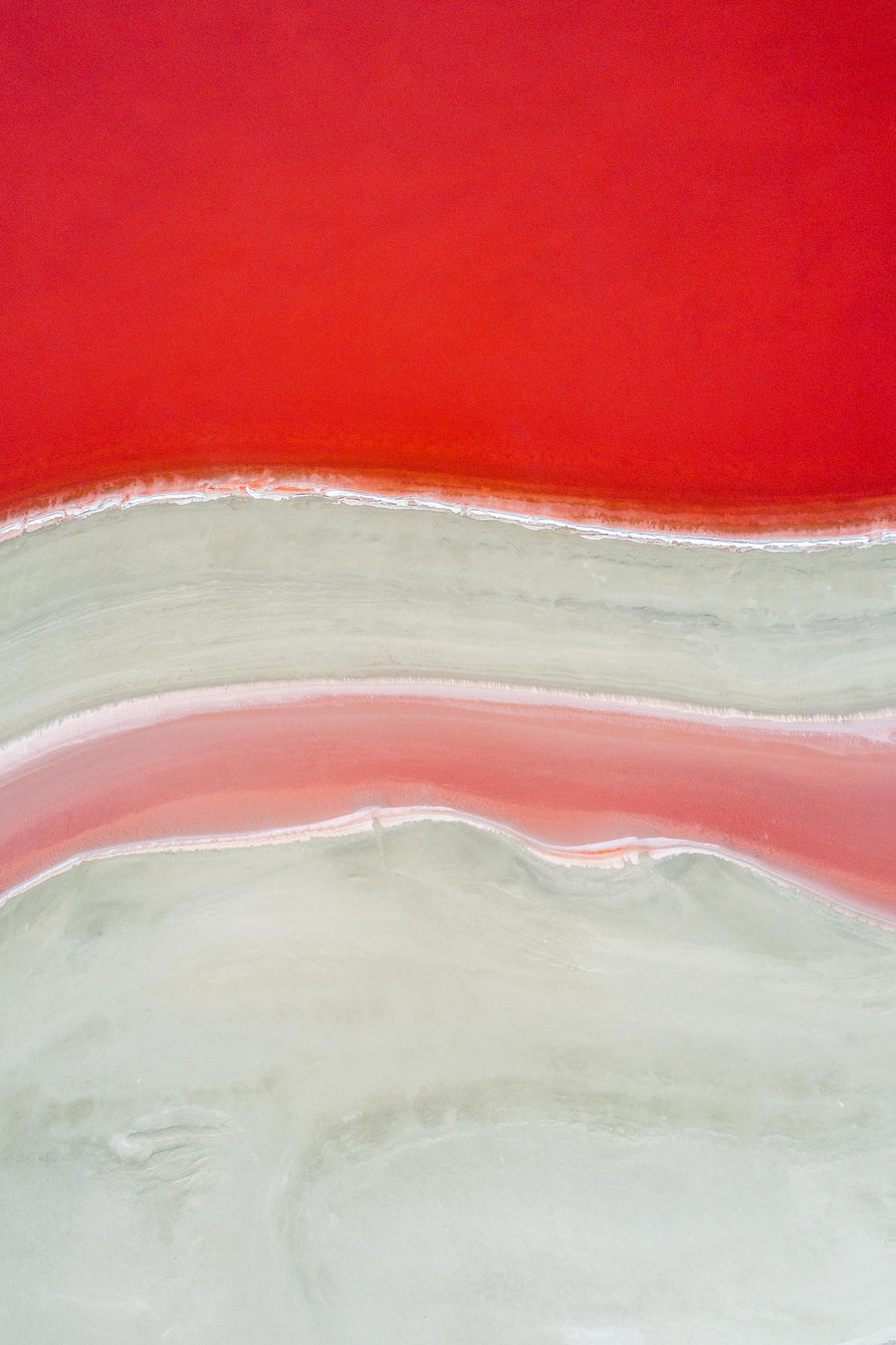 Aerial of red and white wavy lines. Salt lake Stirling Range Western Australia