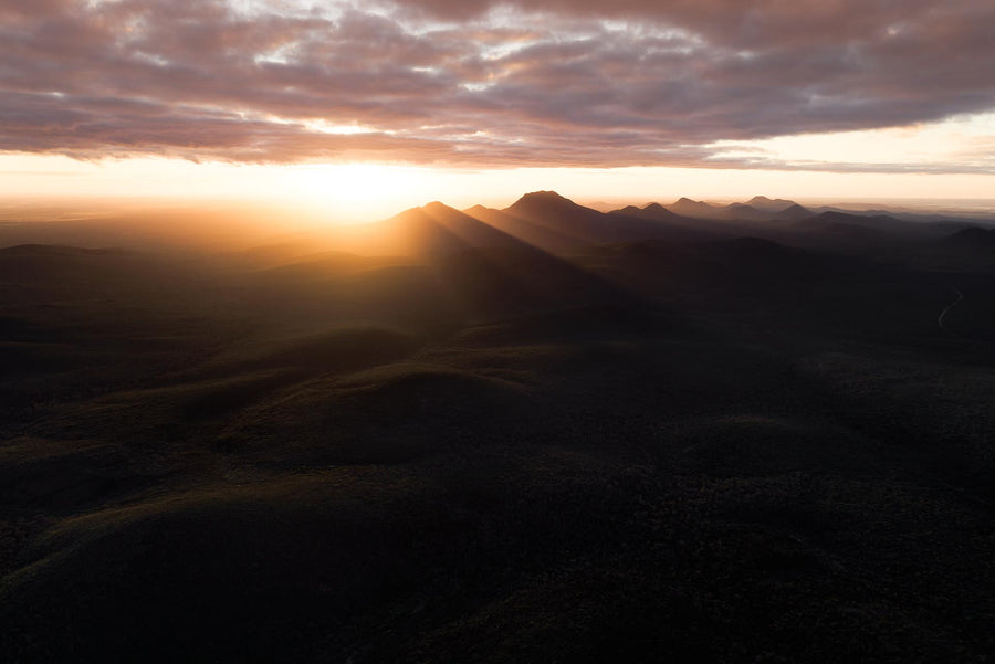 The orange glow of sunrise over the Stirling Range