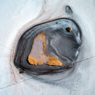 An aerial photograph of a salt lake over the Wheatbelt in Western Australia.  This looks like a bunny or an emperor penguin.  White, black and yellow colours.