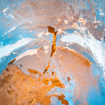 A blue, rust and white coloured aerial abstract of a mid western Australian salt lake, looking more like the planet view from a space ship.