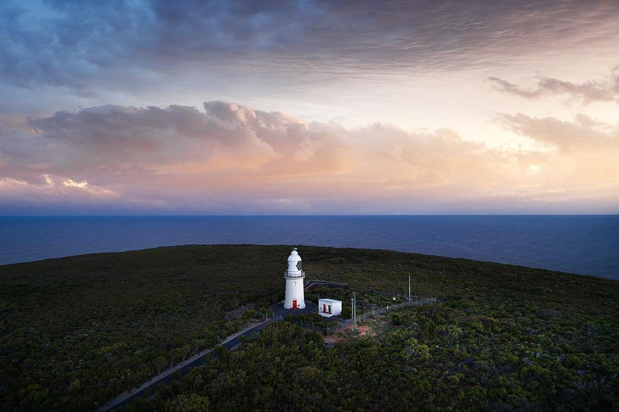 Lighthouse at Cape Naturaliste, South Western Australia, with a pink sunrise overlooking Geographe Bay.