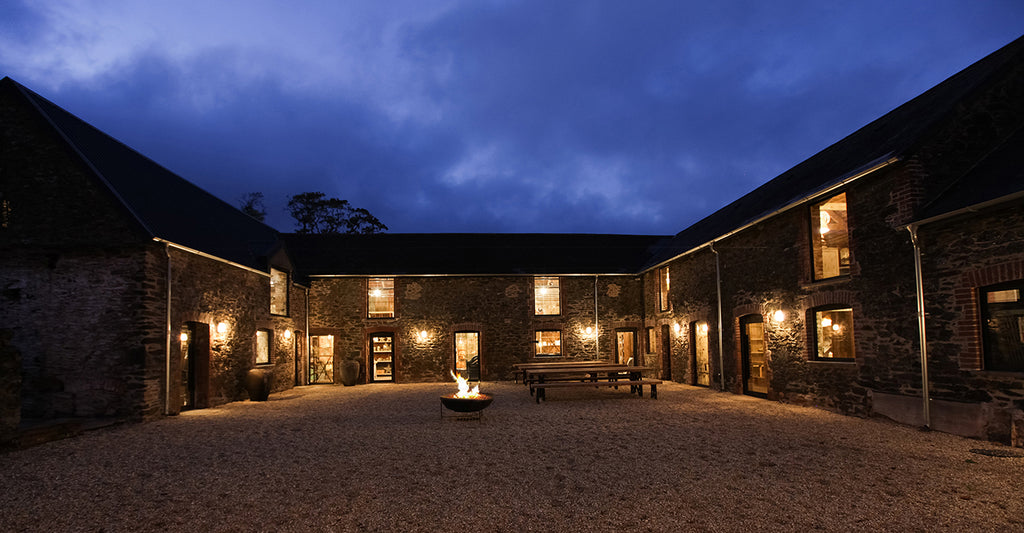 Evening outdoor courtyard Nkuku barns with fire pit