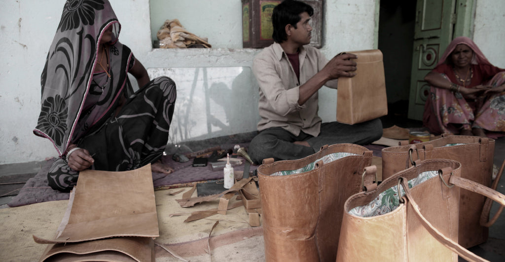 Indian artisan hand making a leather bag