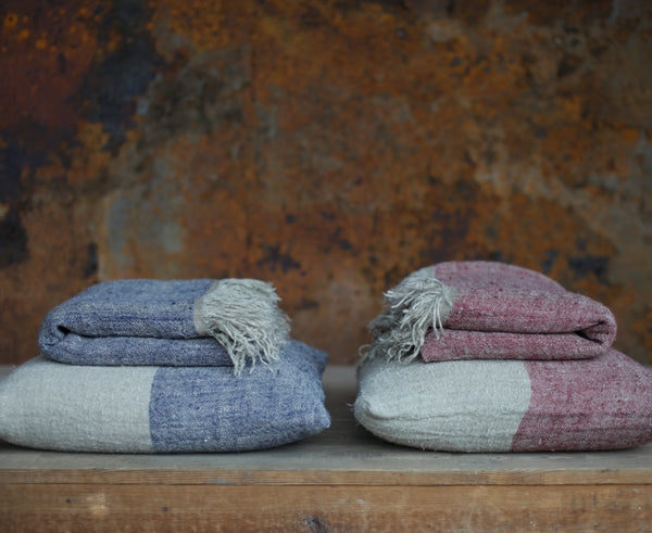 Textured linen cushions and throws in red and blue