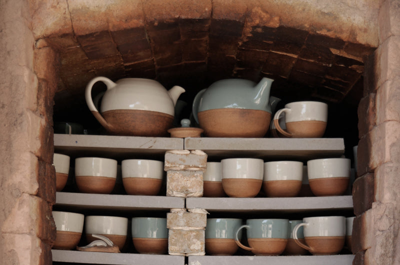 Glazed pots set out on shelves