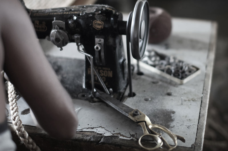 master stitcher at sewing machine