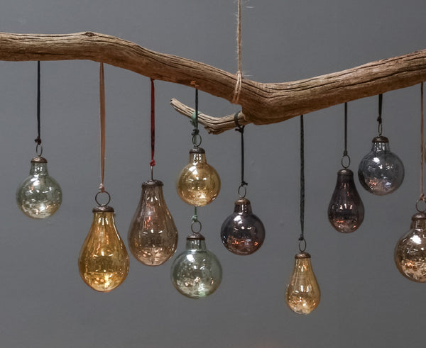 Glass baubles hanging from a branch
