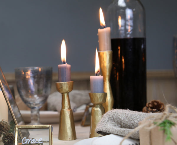 Christmas table scene with brass candlesticks