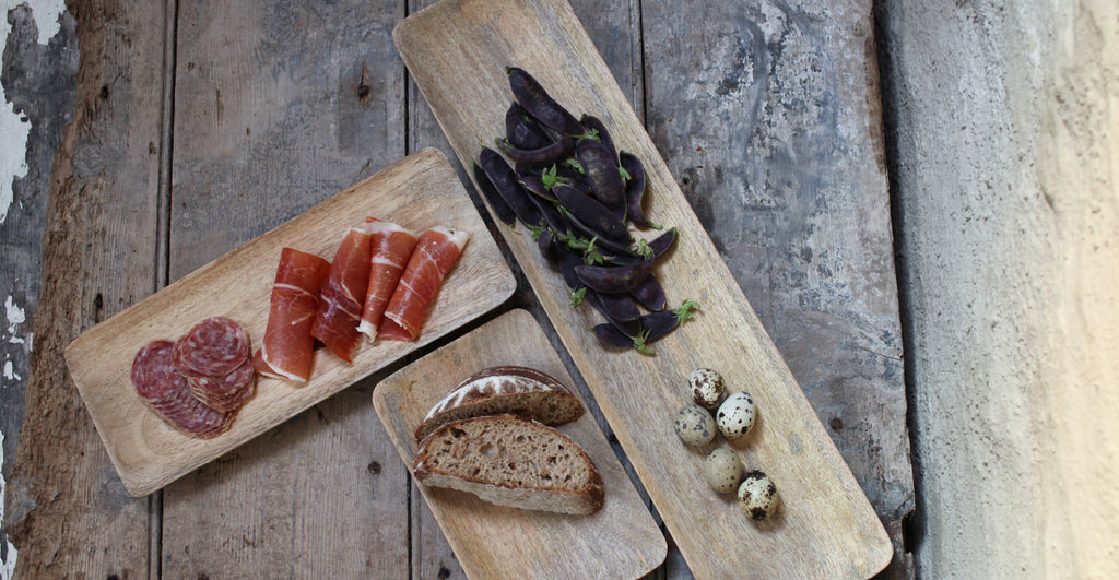 Wooden platters with antipasti
