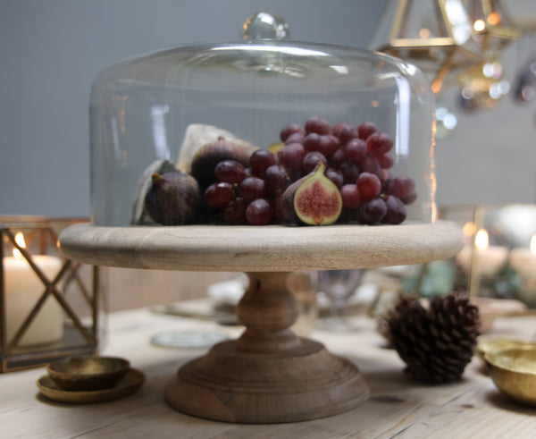 Glass food dome with fruit in