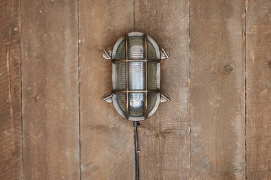 Nkuku LIGHTING Oshi Brass Oval Outdoor Bulkhead Light - Iron