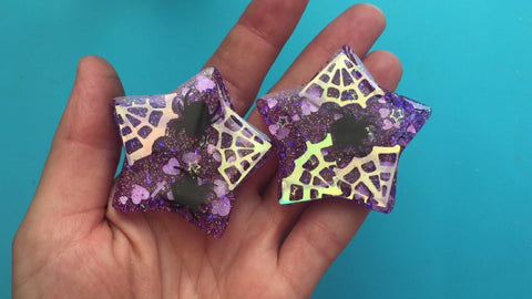 Finished resin charms