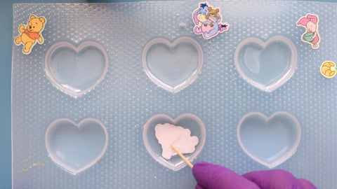 adding stickers to resin