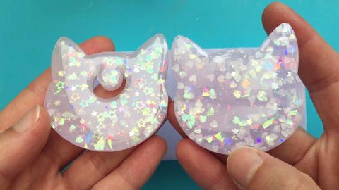 Comparing 2 layer resin charm to 1 layer resin charm after doming with resin
