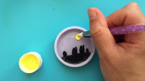 Hand paint the cured resin layer with acrylic paints