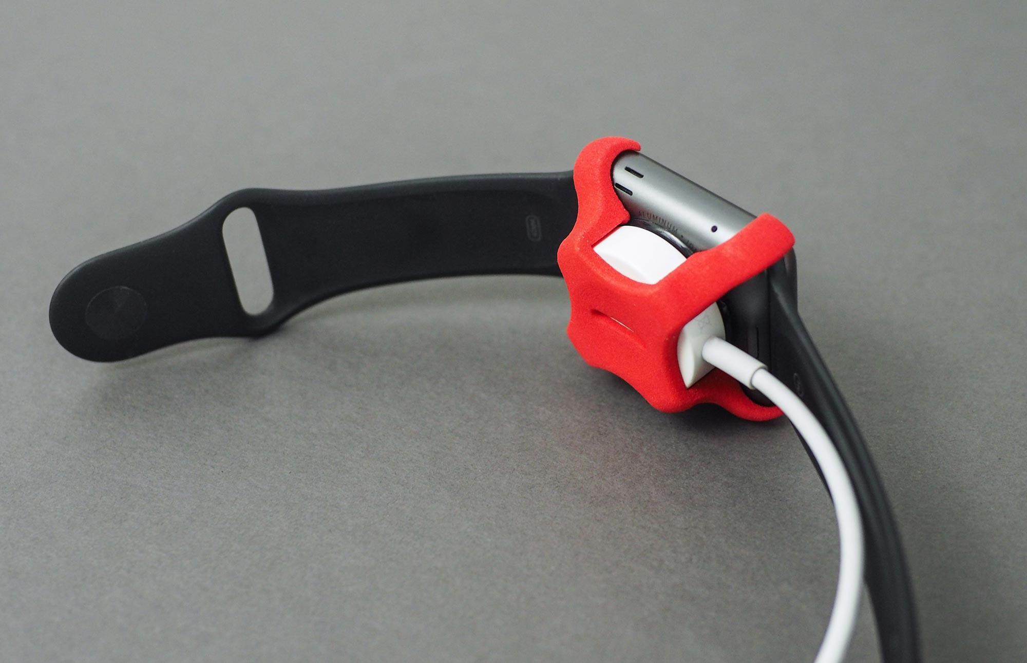 Photo of Apple Watch with charging clip.