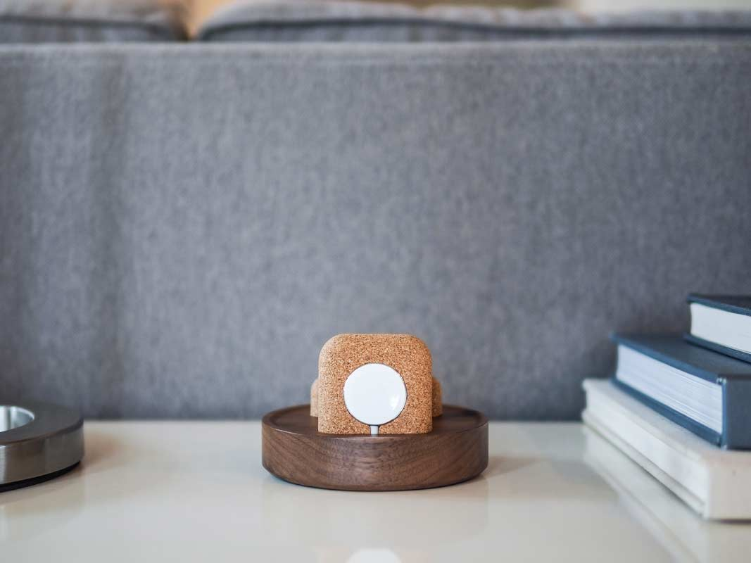 a view of the Apple Watch charging puck in the cork holder on the Material Dock.