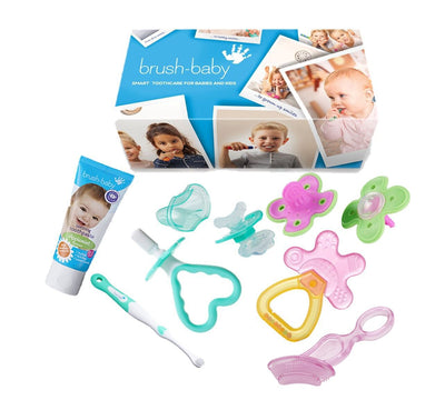 The ultimate teether survival kit for any parent with teething toothpaste, 2 pack of pink and green munch molar, pink and orange coolNcalm rattle teether, pink chewable toothbrush. teal first toothbrush and teether set and front ease teether