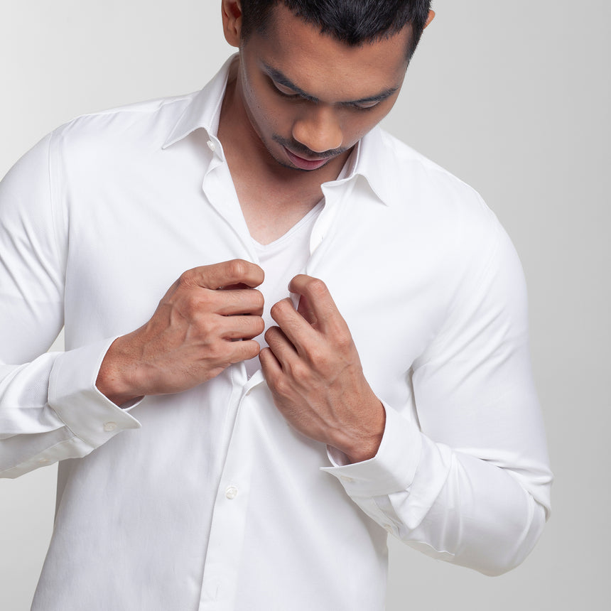 Man in a comfy white v neck undershisrt by Livingwear
