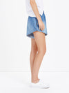 bassike classic raw flared short in classic wash