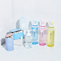The Clean Suite: 7 Refillable, reusable cleaning vessels with tablets or powder. 3 spray Cleaners all in tritan reusable bottles with three tablets. A glass Foaming Hand Soap Bottle and foaming hand soap tablet. A silicone shaker filled with Powder Dish Soap, a refillable tin coated steel container with dishwasher tablets and a tin coated steel container with laundry tablets