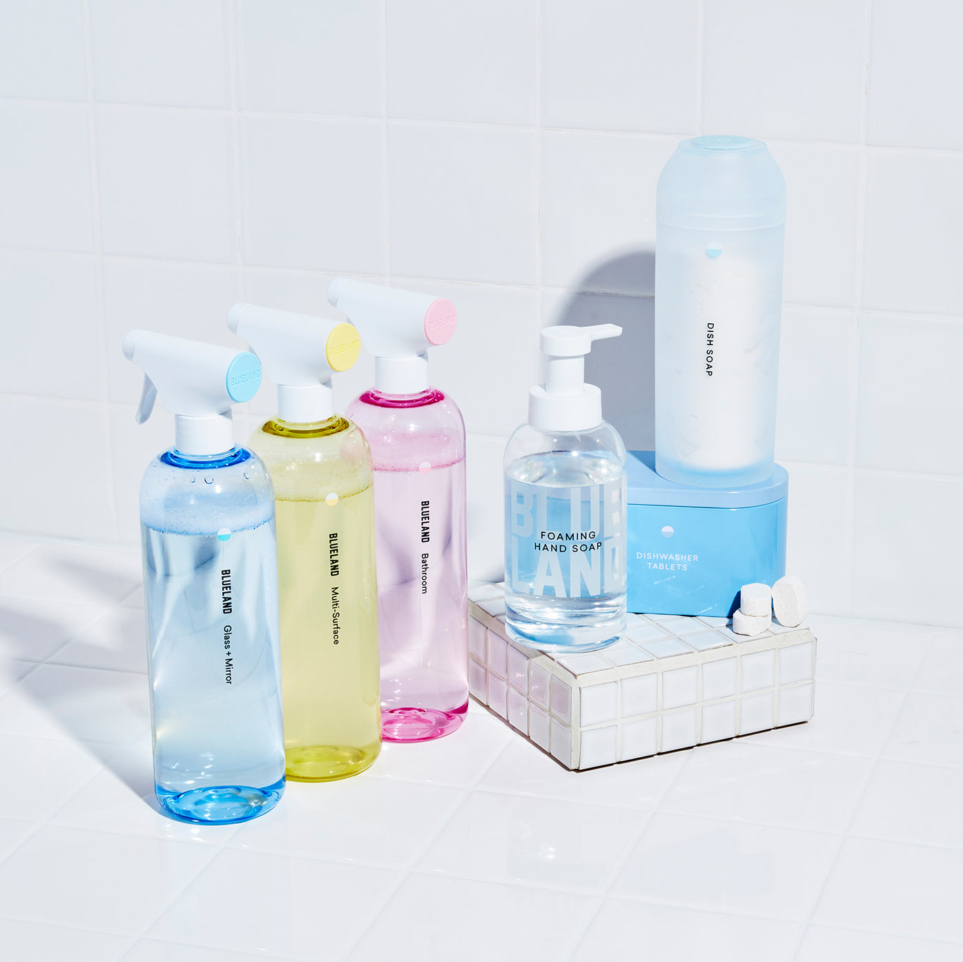 The Everyday Clean: 6 Refillable, reusable cleaning vessels with tablets or powder. 3 spray Cleaners all in tritan reusable bottles with three tablets. A glass Foaming Hand Soap Bottle and foaming hand soap tablet. A silicone shaker filled with Powder Dish Soap, a refillable steel coated tin container with dishwasher tablets.