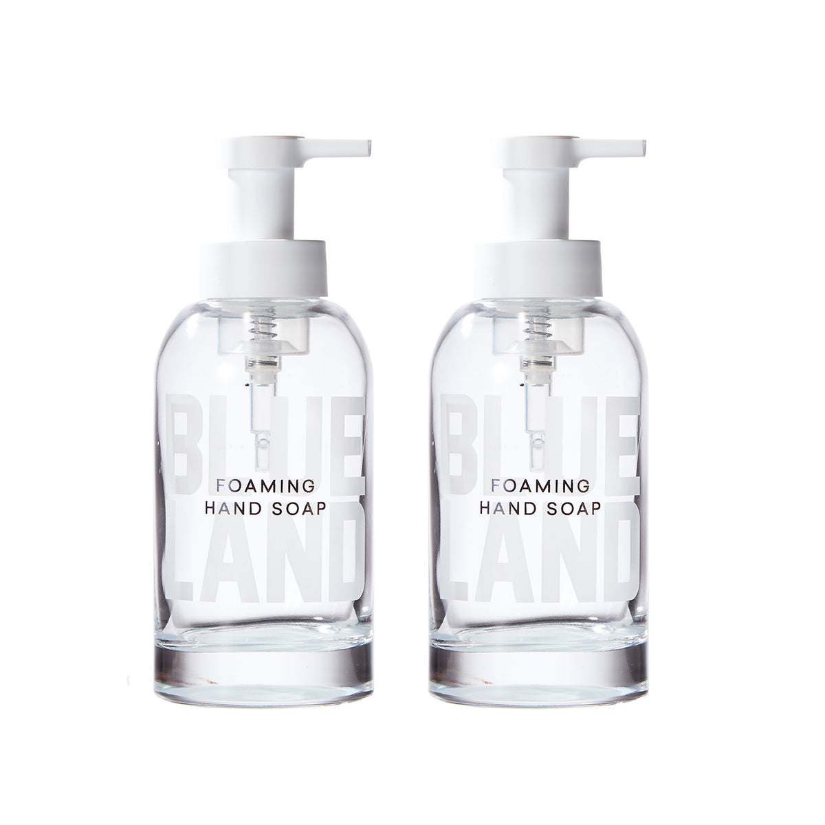 Two reusable glass foaming hand soap bottles on white background