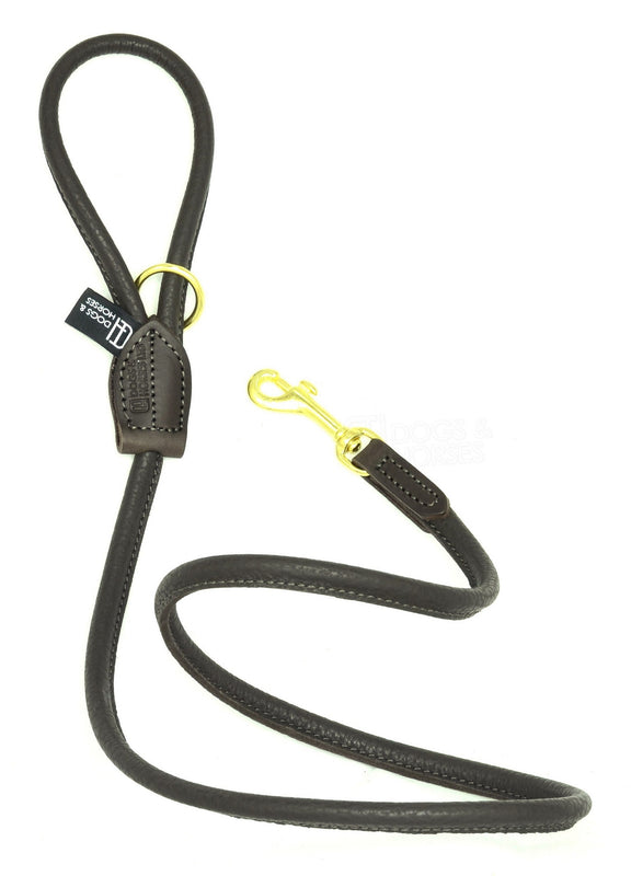 Dogs & Horses dog Lead in soft rolled leather, handmade in England. 130m long by approximately 1cm thick, and finished with a solid brass or silver (nickel-plated brass) trigger hook. In Brown with brass by Keeper & Co.