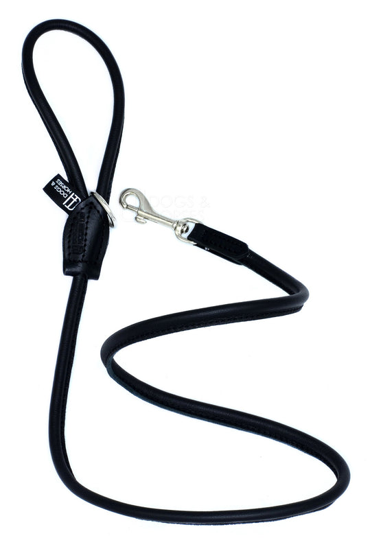 Dogs & Horses dog Lead in soft rolled leather, handmade in England. 130m long by approximately 1cm thick, and finished with a solid brass or silver (nickel-plated brass) trigger hook. In Black with silver by Keeper & Co.