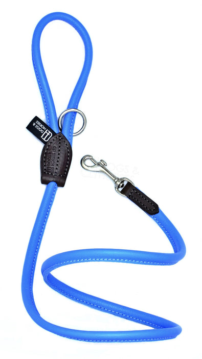 Dogs & Horses dog Lead in soft rolled leather, handmade in England. 130m long by approximately 1cm thick, and finished with a solid brass or silver (nickel-plated brass) trigger hook. In Blue with silver by Keeper & Co.