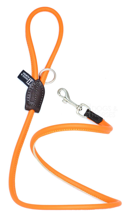 Dogs & Horses dog Lead in soft rolled leather, handmade in England. 130m long by approximately 1cm thick, and finished with a solid brass or silver (nickel-plated brass) trigger hook. In Orange with silver by Keeper & Co.