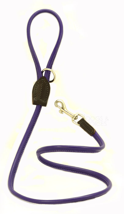 Dogs & Horses dog Lead in soft rolled leather, handmade in England. 130m long by approximately 1cm thick, and finished with a solid brass or silver (nickel-plated brass) trigger hook. In Purple with silver by Keeper & Co.