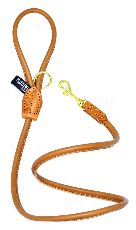 Dogs & Horses dog Lead in soft rolled leather, handmade in England. 130m long by approximately 1cm thick, and finished with a solid brass or silver (nickel-plated brass) trigger hook. In Tan with brass by Keeper & Co.
