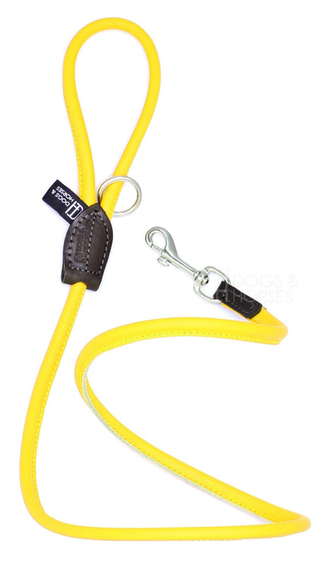 Dogs & Horses dog Lead in soft rolled leather, handmade in England. 130m long by approximately 1cm thick, and finished with a solid brass or silver (nickel-plated brass) trigger hook. In Yellow with silver by Keeper & Co.