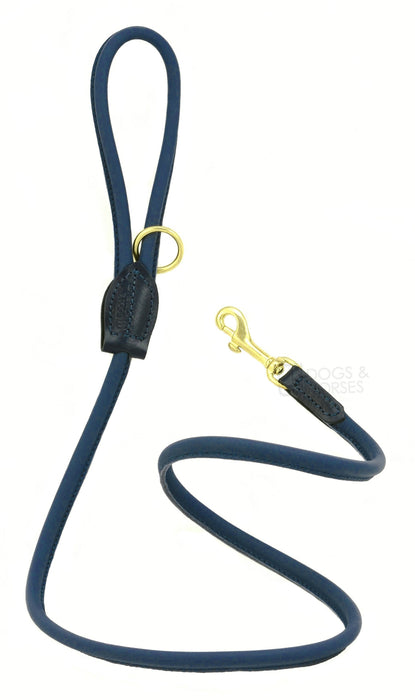 Dogs & Horses dog Lead in soft rolled leather, handmade in England. 130m long by approximately 1cm thick, and finished with a solid brass or silver (nickel-plated brass) trigger hook. In Navy Blue with brass by Keeper & Co.
