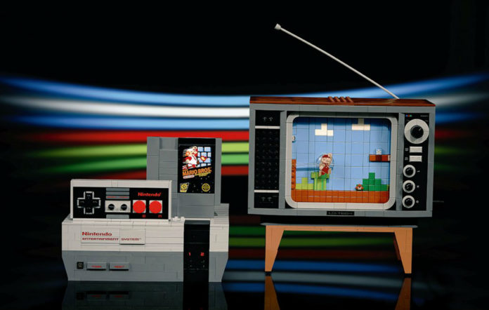 "The new LEGO building set allows you to build a Nintendo NES console and even ""play"" Super Mario Bros 