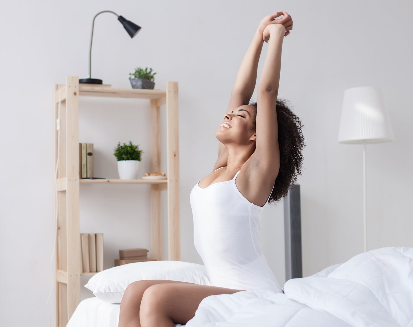happy-woman-wakes-up-and-stretching