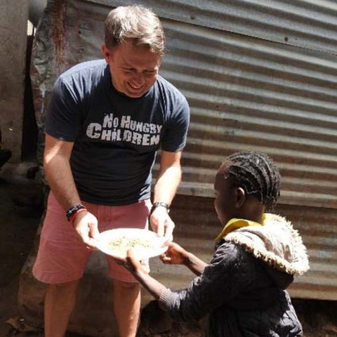 A child receiving a meal from a man