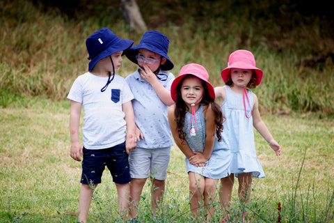 Kids showcasing Jordbarn's bucket hats